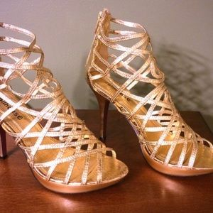 Zipper in back Dollhouse Brand Gold Heels, Size 9